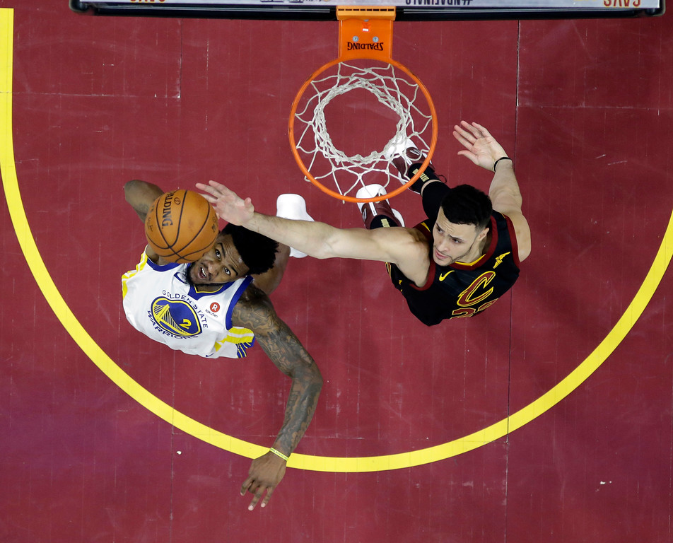 . Golden State Warriors\' Jordan Bell and Cleveland Cavaliers\' Larry Nance Jr. reach for a rebound during the second half of Game 4 of basketball\'s NBA Finals, Friday, June 8, 2018, in Cleveland. (AP Photo/Carlos Osorio, Pool)
