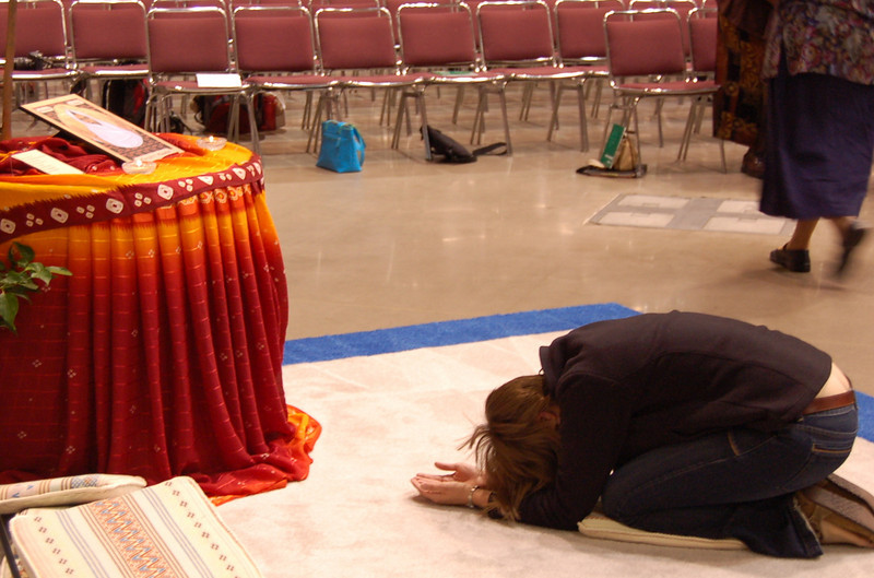 Praying at one of several prayer stations arranged around the periphery of the worship center.