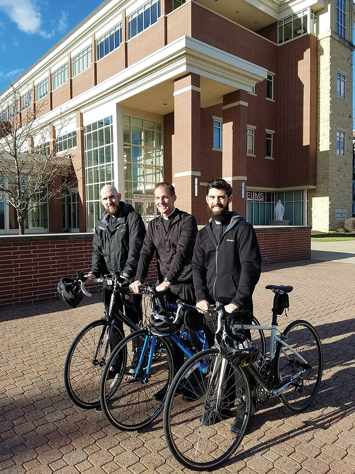 VOCATIONS-PRIESTS-PEDALING