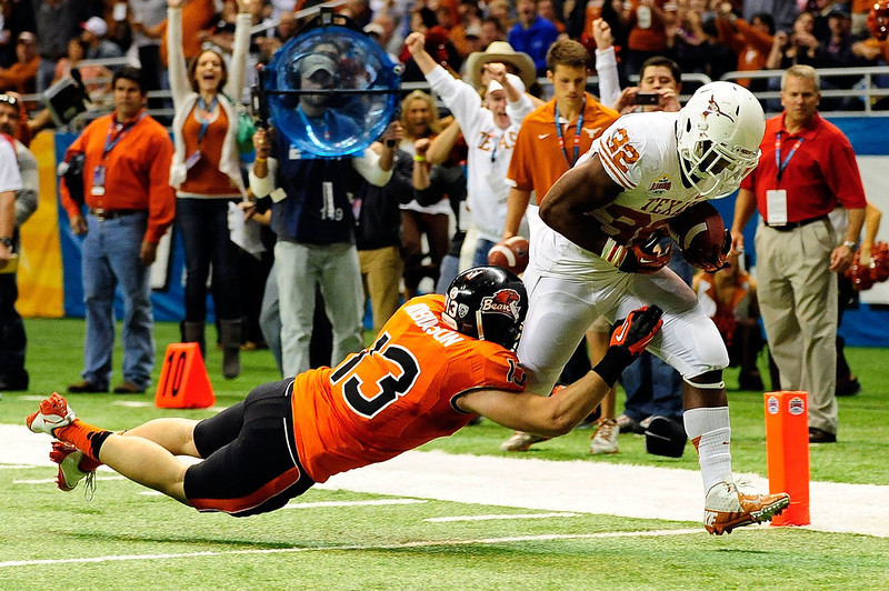 . Johnathan Gray #32 of the University of Texas Longhorns scores on Rueben Robinson #13 of the Oregon State Beavers during the Valero Alamo Bowl at the Alamodome on December 29, 2012 in San Antonio, Texas. Texas won the game 31-27.   (Photo by Stacy Revere/Getty Images)