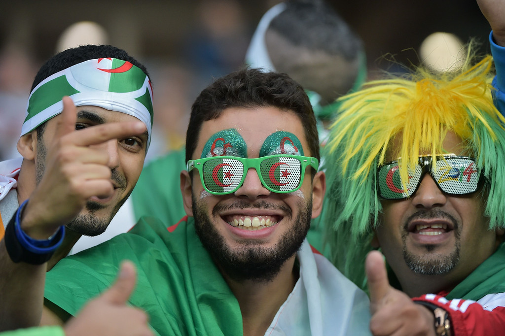 . Algeria fans cheer as they await the kick-off of the Round of 16 football match between Germany and Algeria at Beira-Rio Stadium in Porto Alegre during the 2014 FIFA World Cup on June 30, 2014.  GABRIEL BOUYS/AFP/Getty Images