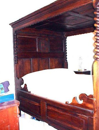Guest room - 18th century oak tester bed bought at an estate auction. The previous owner bought it at Sotheby's.