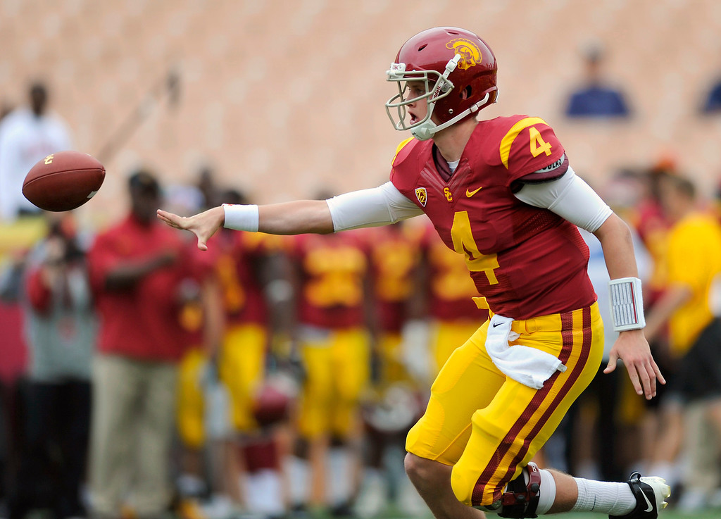 . QB Max Browne does a shovel pass at USC\'s Spring Football Game. (Michael Owen Baker/Staff Photographer)
