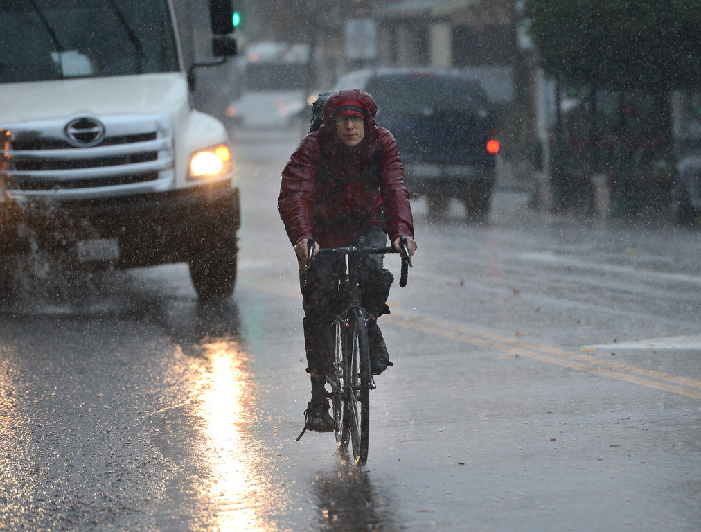 . A bike rider braves the weather in Los Gatos, Calif., on Thursday, Dec. 11, 2014. The big storm made its way south, after pounding the North Bay in the early morning hours. (Dan Honda/Bay Area News Group)