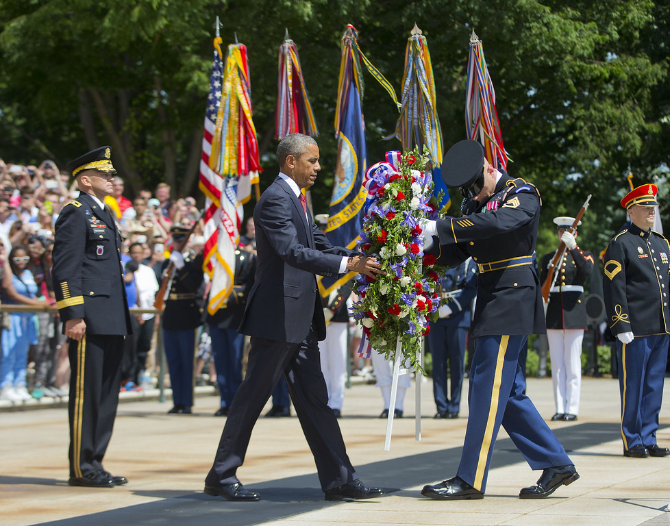 . President Barack Obama, accompanied by Maj. Gen. Jeffrey S. Buchanan, left, Commander of the U.S. Army Military District of Washington, and the with the aid of  Sgt. 1st Class John C. Wirth, lays a wreath at the Tomb of the Unknowns, on Memorial Day, Monday, May 25, 2015, at Arlington National Cemetery in Arlington, Va.  (AP Photo/Pablo Martinez Monsivais)