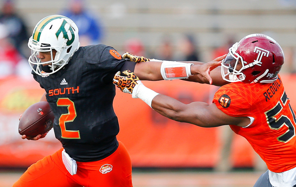 . South quarterback Antonio Pipkin (2) of Tiffin stiff-arms North inside linebacker Haason Reddick of Temple during the second half of the Senior Bowl college football game, Saturday, Jan. 28, 2017, at Ladd�Peebles Stadium, in Mobile, Ala. The South won 16-15. (AP Photo/Brynn Anderson)