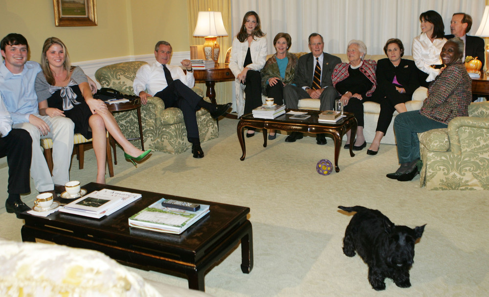 Description of . Member of Bush family and friends gather around to watch early poll result in the residence of the White House, from left to right, Sam Leblond, nephew, daughter Jenna, President Bush, daughter Barbara, first lady Laura Bush, President Bush's father, former President George H. W. Bush, former first lady Barbara Bush, sister Dora Koch, sister-in-law Maria and her husband Neil Bush and family friend Lois Betts Tuesday, Nov. 2, 2004. Walking out the room is their dog Barney. (AP Photo/Pablo Martinez Monsivais)