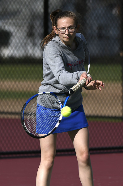 4/26/2018 Mike Orazzi | Staff St. Paul's Katie Pauloz during Thursday's tennis match with Ansonia in Page Park.