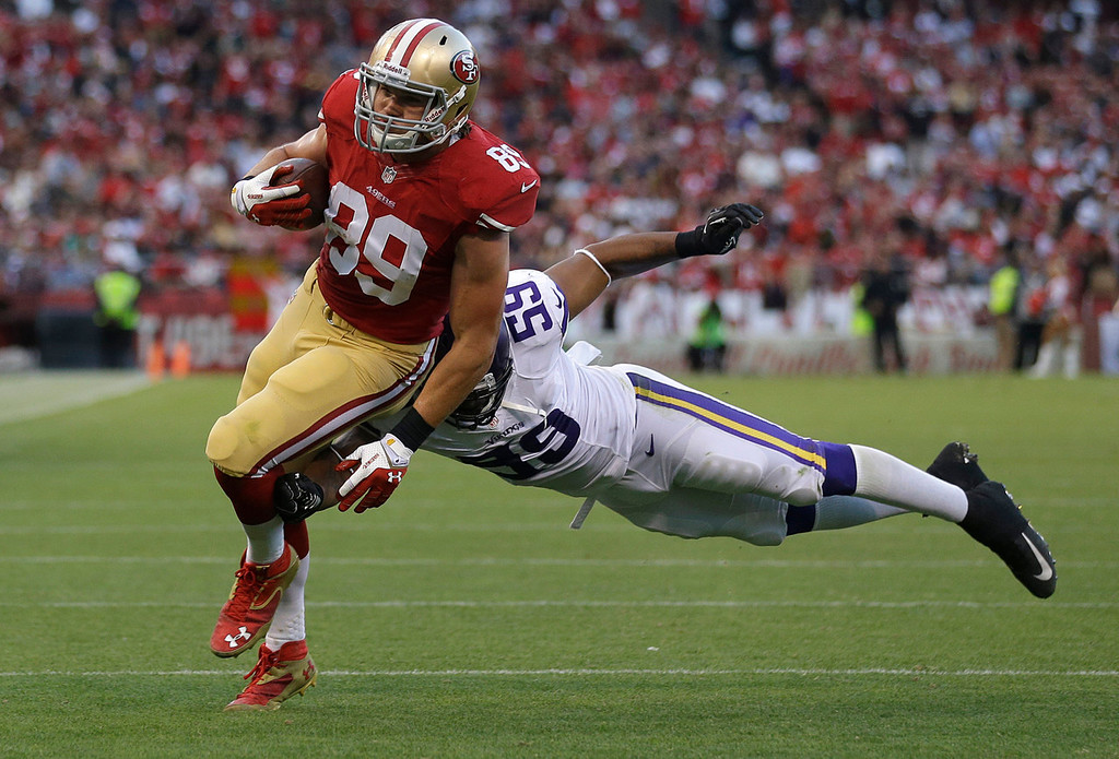 . 49ers tight end Vance McDonald  is tackled by Vikings linebacker Desmond Bishop during the third quarter. (AP Photo/Marcio Jose Sanchez)
