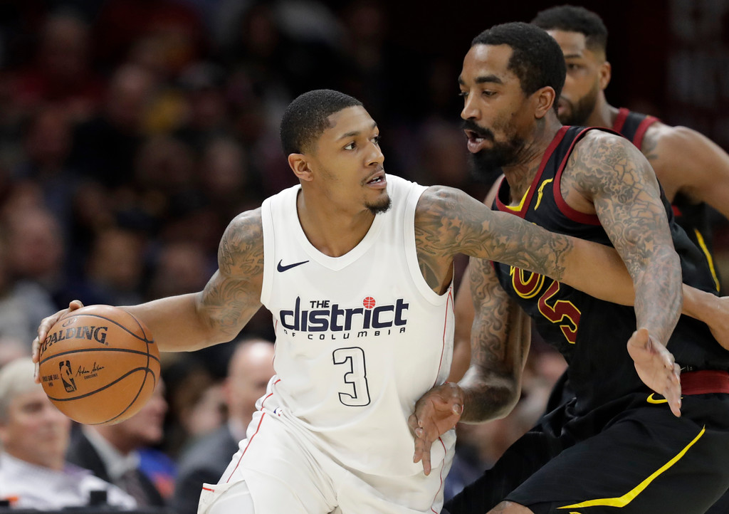 . Washington Wizards\' Bradley Beal (3) drives past Cleveland Cavaliers\' JR Smith (5) in the first half of an NBA basketball game, Thursday, April 5, 2018, in Cleveland. (AP Photo/Tony Dejak)