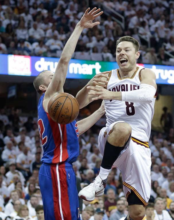 . Cleveland Cavaliers\' Matthew Dellavedova (8), from Australia, loses control of the ball against Detroit Pistons\' Steve Blake (22) in the first half in Game 1 of a first-round NBA basketball playoff series, Sunday, April 17, 2016, in Cleveland. (AP Photo/Tony Dejak)