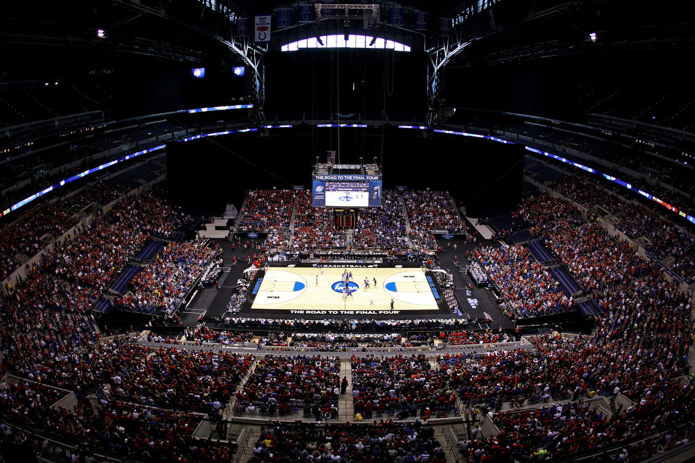 . A general view of the opening tip-off between the Louisville Cardinals and the Duke Blue Devils during the Midwest Regional Final round of the 2013 NCAA Men\'s Basketball Tournament at Lucas Oil Stadium on March 31, 2013 in Indianapolis, Indiana.  (Photo by Chris Chambers/Getty Images)