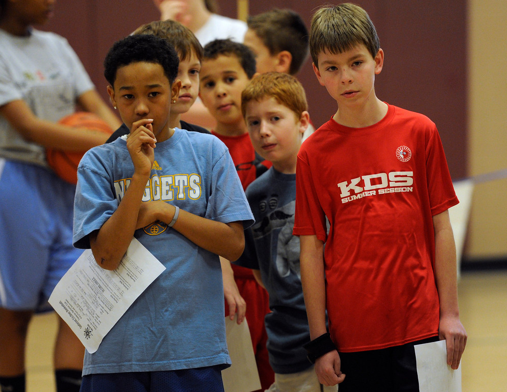 . DENVER, CO. - FEBRUARY 23: Kids watch and wait for their turn at the passing skill test. The Tamarac Optimist Club sponsors one of the Tri-Star Basketball Competitions at the Eisenhower Recreation Center in Denver. The competitions are held over a several week period for boys and girls 8-13 years-old. The winners from this competition go on to the regional finals, and those winners will play in the final competition on Mar. 23, 2013 at the Pepsi Center before a Nuggets game. There are still several opportunities for kids to try out. Go to www.tristarbasketball.org for upcoming times and locations. (Photo By Kathryn Scott Osler/The Denver Post)