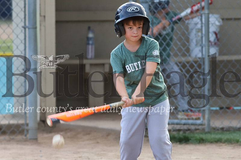 Isaac Hinderliter takes a swing at a ball during Butler little league's final 7U game of the season Wednesday 07/22/20(Fields behind St. Fidellis). Seb Foltz/Butler Eagle