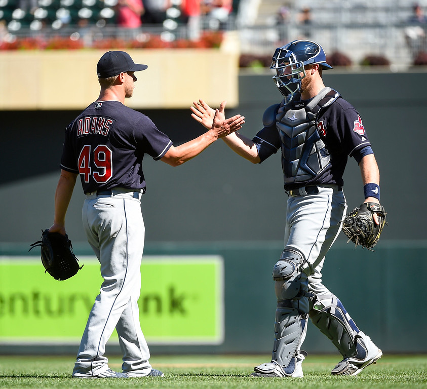 . Cleveland Indians pitcher Austin Adams, left, celebrates with catcher Yan Gomes after defeating the Minnesota Twins 6-1 during their baseball game Sunday, July 17, 2016, in Minneapolis. (AP Photo/Craig Lassig)