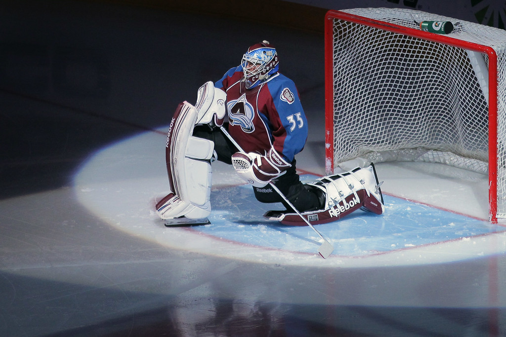 . Goalie Jean-Sebastien Giguere #35 of the Colorado Avalanche prepares to face the Tampa Bay Lightning at the Pepsi Center on December 23, 2011 in Denver, Colorado. The Avalanche defeated the Lightning 2-1 in overtime.  (Photo by Doug Pensinger/Getty Images)