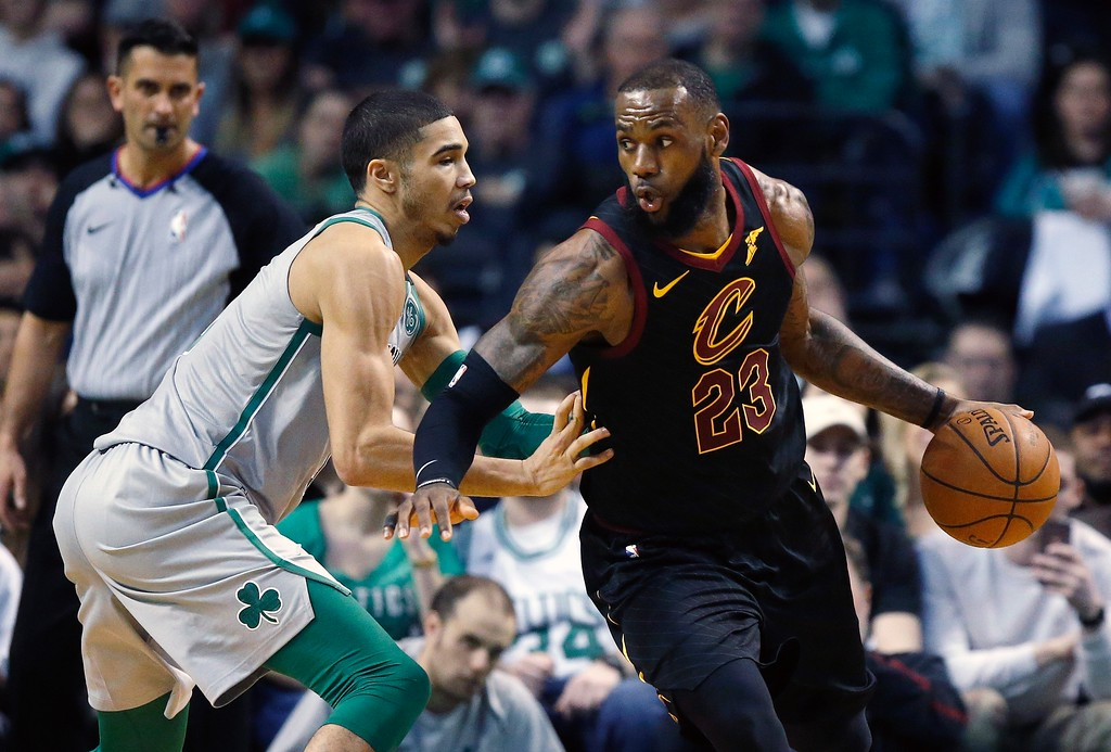 . Cleveland Cavaliers\' LeBron James (23) drives past Boston Celtics\' Jayson Tatum during the second quarter of an NBA basketball game in Boston, Sunday, Feb. 11, 2018. (AP Photo/Michael Dwyer)