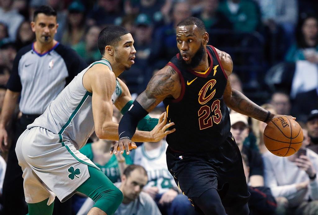 . Cleveland Cavaliers\' LeBron James (23) drives past Boston Celtics\' Jayson Tatum during the second quarter of an NBA basketball game in Boston, Sunday, Feb. 11, 2018. (AP Photo/Michael Dwyer)