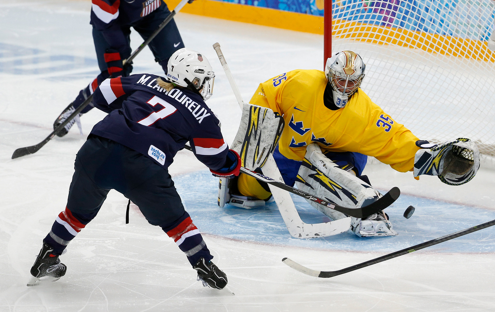 . Monique Lamoureux of the United States takes  shot against Goalkeeper Valentina Wallner of Sweden during the second period of the 2014 Winter Olympics women\'s semifinal ice hockey game at Shayba Arena Monday, Feb. 17, 2014, in Sochi, Russia. (AP Photo/Julio Cortez)
