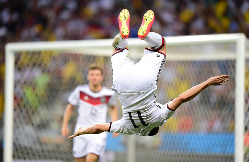 . Germany\'s forward Miroslav Klose (R) celebrates after scoring during a Group G football match between Germany and Ghana at the Castelao Stadium in Fortaleza during the 2014 FIFA World Cup on June 21, 2014. (JAVIER SORIANO/AFP/Getty Images)