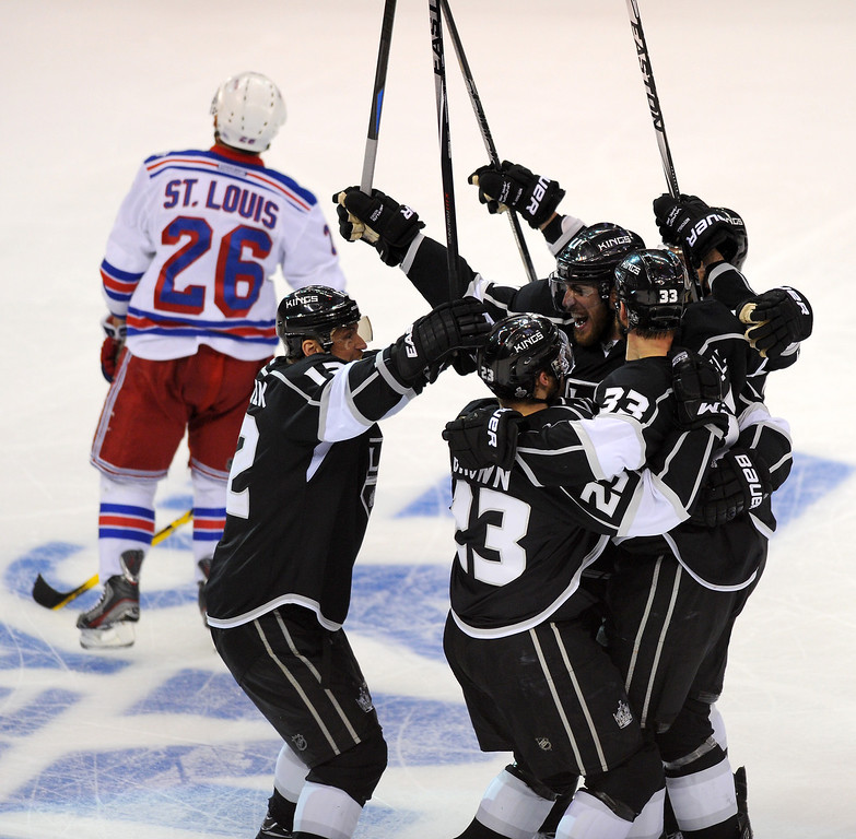 . The Kings mob Dustin Brown (#23) after Brown scored the winning goal in the second overtime to beat the Rangers 5-4 in game two of the Stanley Cup Final, Saturday, June 7, 2014, at Staples Center. (Photo by Michael Owen Baker/Los Angeles Daily News)