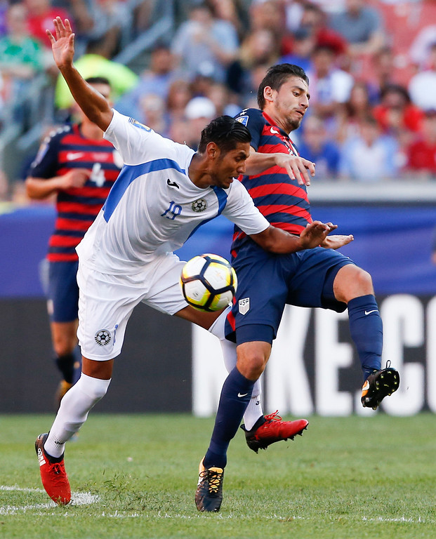 . United States\' Alejandro Bedoya (11) and Nicaragua\'s Luis Peralta (19) vie for the ball during a CONCACAF Gold Cup soccer match in Cleveland, Saturday, July 15, 2017. (AP Photo/Ron Schwane)
