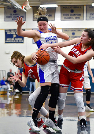 2/6/2020 Mike Orazzi | StaffrBristol Eastern's Avery Arbuckle (42) and Berlin's Clare McGeever (21) and Ashley Wenzel (10) at Bristol Eastern Thursday night. r