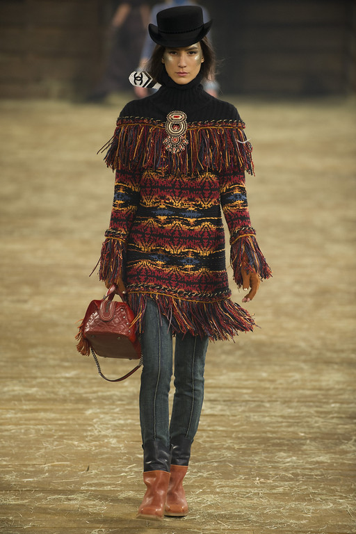 ". A model walks the runway during the Chanel ""Metiers d\'Art\"" Show at Fair Park on December 10, 2013 in Dallas, Texas.  (Photo by Cooper Neill/Getty Images for Chanel)"
