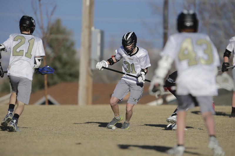 JPM0308-JPM0308-Jonathan first HS lacrosse game March 9th.jpg