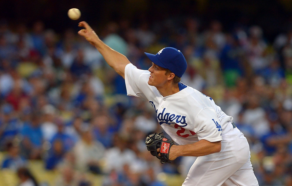 . Los Angeles Dodgers starting pitcher Zack Greinke delivers a pitch against the Chicago Cubs August 26, 2013 in Los Angeles, CA.(Andy Holzman/Los Angeles Daily News)