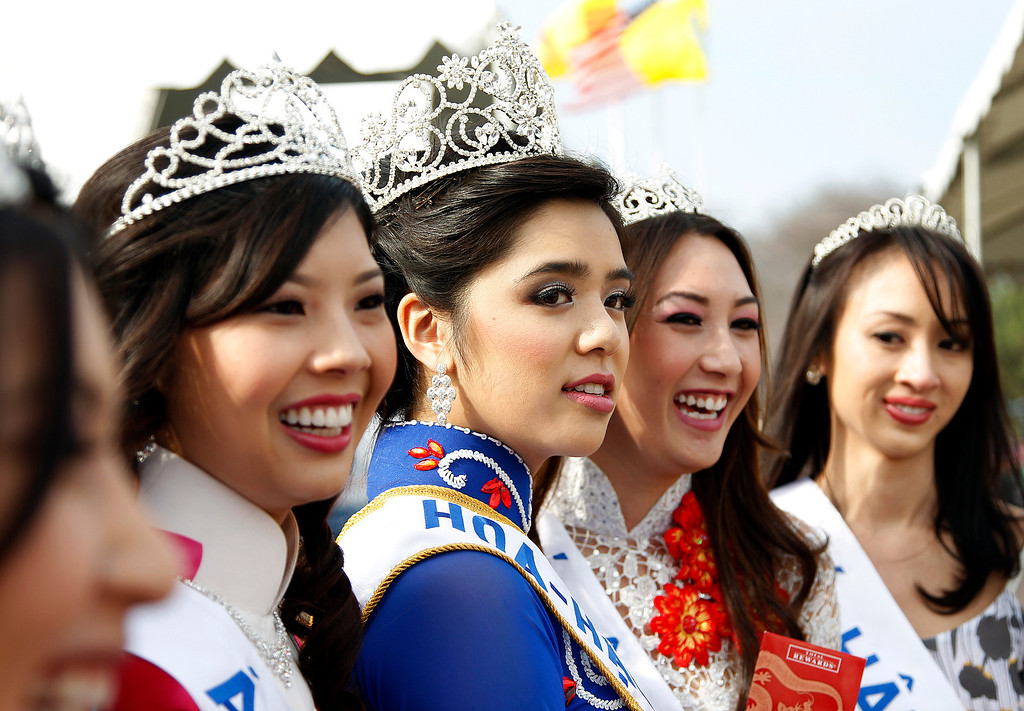 . From left, Phung Hoang Truong (1st Princess for Miss Vietnam of Northern California), Tranle Nguyen Minh (Miss Vietnam of Northern California), Nguyen Diem Sandy (Miss Congeniality for Miss Vietnam of Northern California), and Vu Anh Thu (2nd Princess for Miss Vietnam of Northern California), pose for photographers at the Tet festival hosted by the Coalition of Nationalist Vietnamese Organizations of Northern California (CONVONCA) at the Santa Clara County Fairgrounds in San Jose, Calif. on Saturday, February 2, 2013.   (LiPo Ching/Staff)