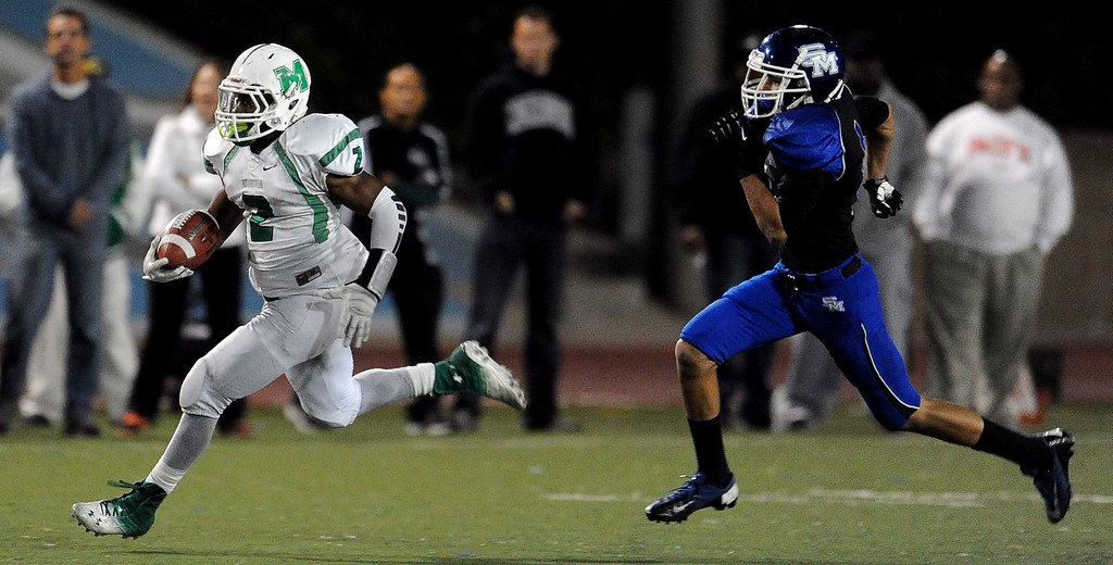 . Monrovia\'s Kurt Scoby (2) runs for a 82 yard touchdown against San Marino in the first half of a prep football game at Monrovia High School in Monrovia, Calif., on Friday, Nov. 8, 2013.    (Keith Birmingham Pasadena Star-News)