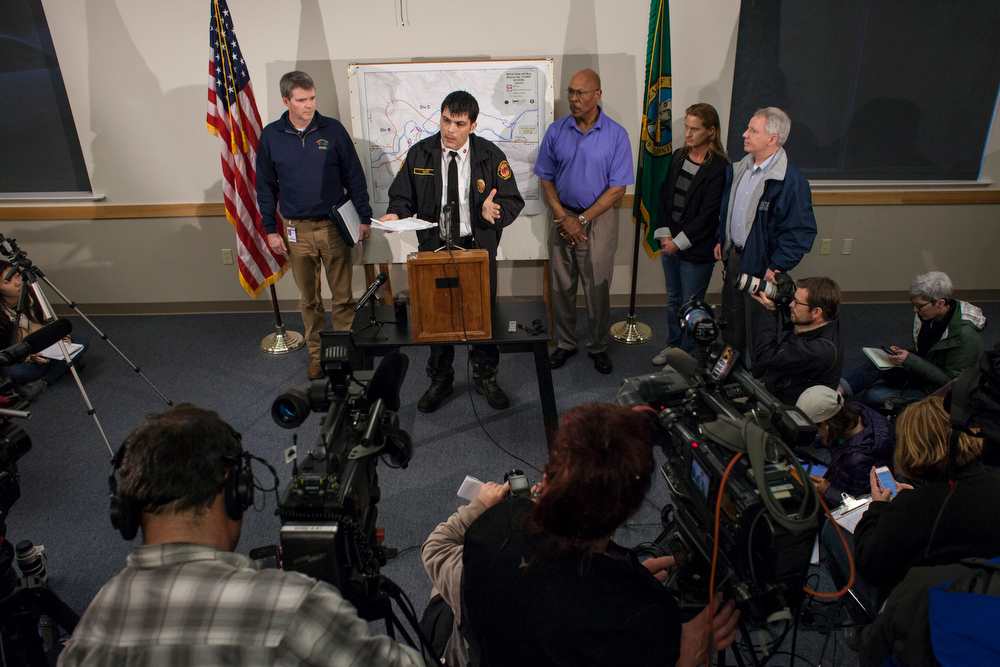 . Snohomish County Fire District 21 Chief Travis Hots speaks to the media during a news conference on March 25, 2014 in Arlington, Washington. A massive mudslide on March 22 in nearby Oso, Washington killed at least sixteen and left many missing. (Photo by David Ryder/Getty Images)
