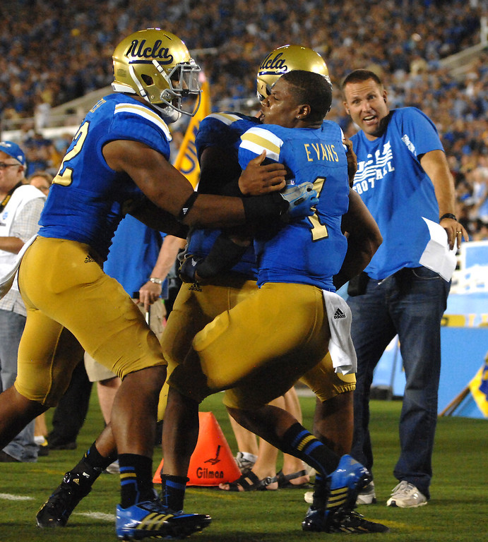 . UCLA WR Shaquelle Evans, right, is congratulated after a second-quarter touchdown reception against Nevada, Saturday, August 31, 2013, at the Rose Bowl. (Michael Owen Baker/L.A. Daily News)