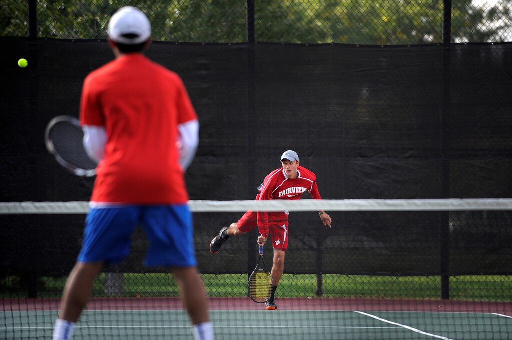 . DENVER, CO. - OCT 12:   Fairview\'s Max Petrak hits during the #1 doubles match as Cherry Creek\'s Harshil Dwivedi waits on the opposing side. Cherry Creek defeated Fairview in the #1 doubles match during the final day of the 5A Boys\' Tennis Championships at Gates Tennis Center on Oct. 12, 2013.  (Photo By Erin Hull/The Denver Post)