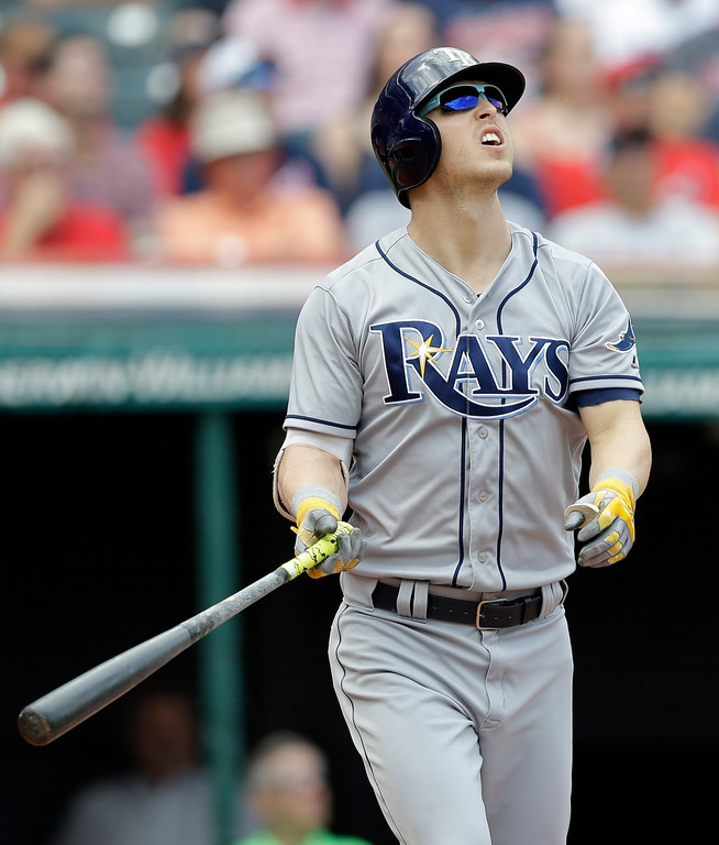 . Tampa Bay Rays\' Corey Dickerson watches his ball after hitting a three-run home run off Cleveland Indians starting pitcher Josh Tomlin in the second inning of a baseball game, Wednesday, May 17, 2017, in Cleveland. Jesus Sucre and Daniel Robertson scored on the play. (AP Photo/Tony Dejak)