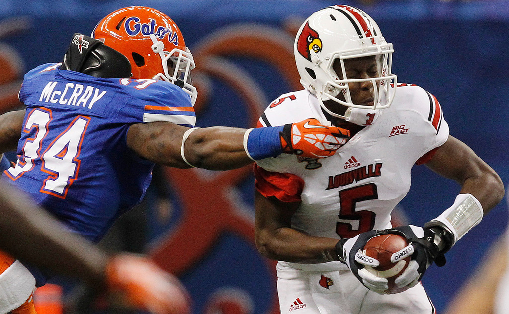 . Louisville quarterback Teddy Bridgewater (5) is sacked by Florida linebacker Lerentee McCray (34) in the first half of the Sugar Bowl NCAA college football game Wednesday, Jan. 2, 2013, in New Orleans. (AP Photo/Butch Dill)