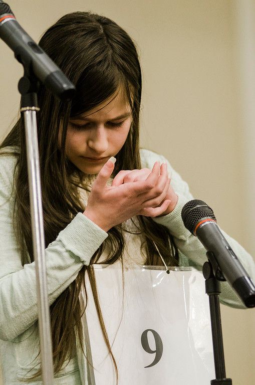 . Amy Vivance, of Luther Burbank Middle School, spells a word in her hand during the 2017 North Central Massachusetts Regional Spelling Bee, sponsored by the Sentinel & Enterprise, at the DoubleTree by Hilton Hotel in Leominster on Tuesday, March 21. SENTINEL & ENTERPRISE / Ashley Green