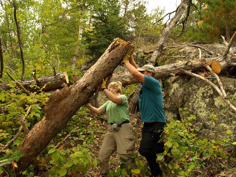 Joe and Eva swing out pine log on Sunday morning.