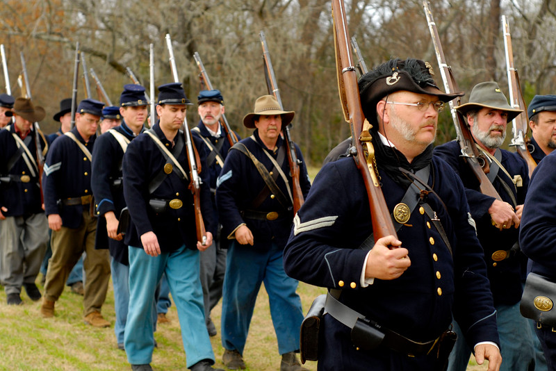Reenactors for the 12th Indiana Infantry march across a field just before the reenactment. The Skirmish at Gamble's Hotel happened on March 5, 1885 when 500 federal soldiers, under the command of Reuben Williams of the 12th Indiana Infantry, marched into Florence to destroy the railroad depot but were met by Confederate soldiers backed up with 400 militia. The reenactment, held by the 23rd South Carolina Infantry, was held at the Rankin Plantation in Florence, South Carolina on Saturday, March 5, 2011. Photo Copyright 2011 Jason Barnette