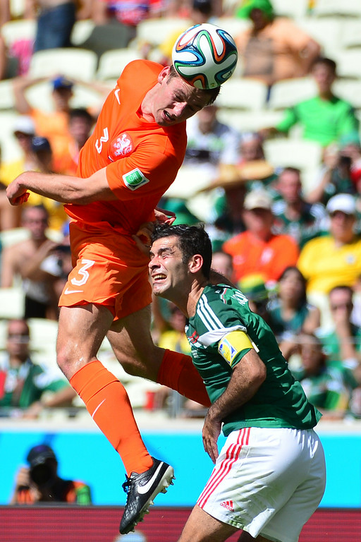 . Netherlands\' defender Stefan de Vrij (L) vies with Mexico\'s defender and captain Rafael Marquez during a Round of 16 football match between Netherlands and Mexico at Castelao Stadium in Fortaleza during the 2014 FIFA World Cup on June 29, 2014.   AFP PHOTO/ YURI CORTEZ