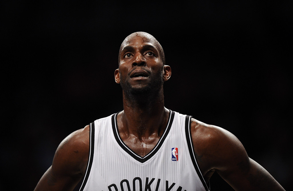 . NEW YORK, NY - DECEMBER 03:  Kevin Garnett #2 of the Brooklyn Nets looks on during the first half against the Denver Nuggets at Barclays Center on December 3, 2013 in the Brooklyn borough of New York City. The Nuggets defeat the Nets 111-87. (Photo by Maddie Meyer/Getty Images)