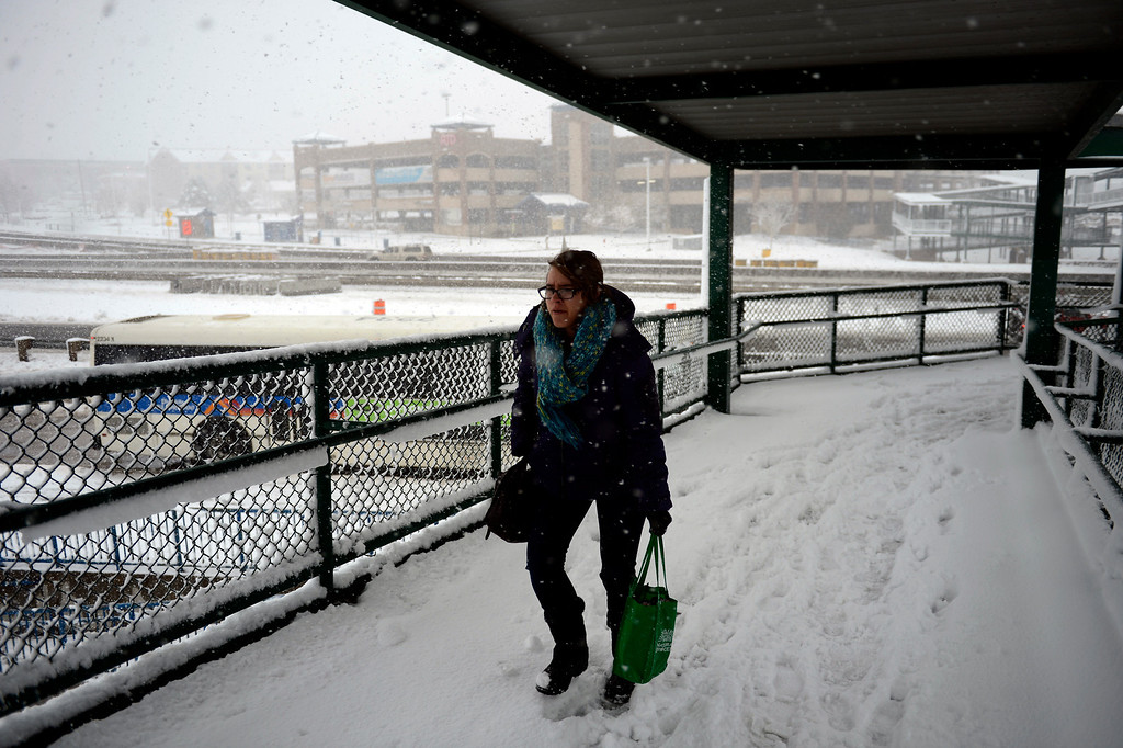 . ARVADA, CO. - MARCH 09: Miranda Tanner of Thornton marches for the next bus after missing one at the park and ride at 88th and Wadsworth in Arvada as the snow continues to fall March 09, 2013. Arvada, Colorado. (Photo By Joe Amon/The Denver Post)