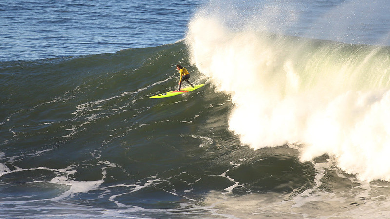 . Surfer Ken Collins takes off on a wave during the first heat of the Mavericks Invitational on Sunday, Jan. 20, 2013 near Half Moon Bay, Calif.  (Aric Crabb/Staff)