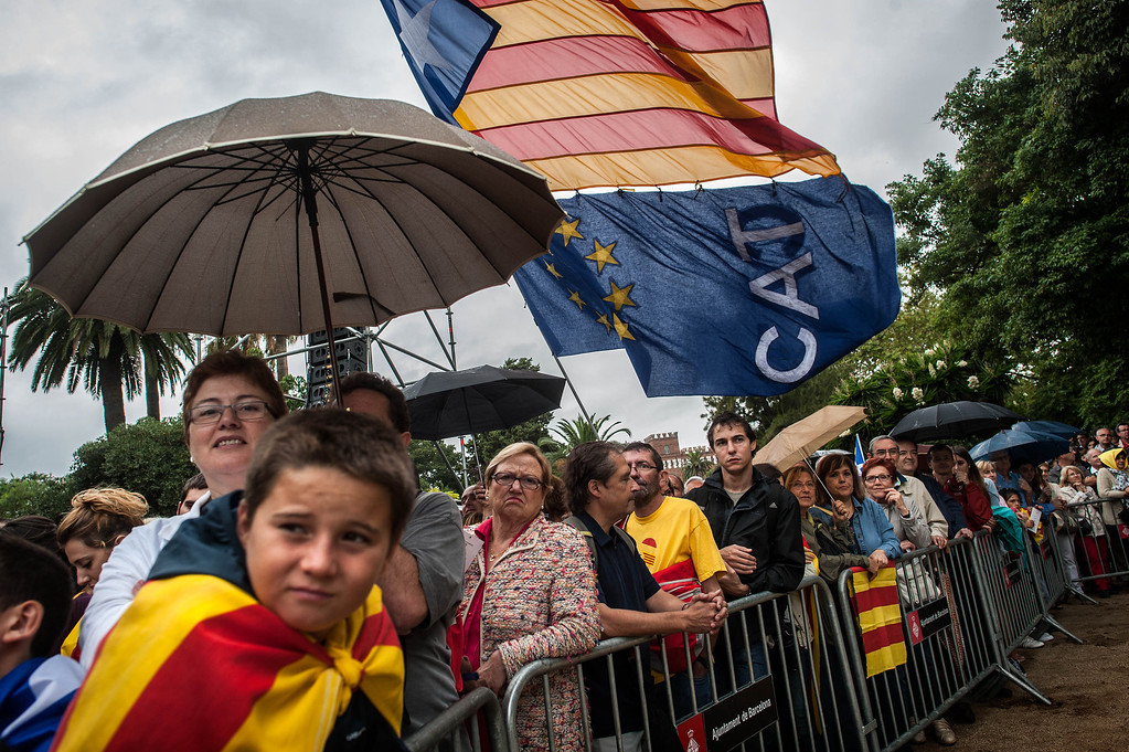. BARCELONA, SPAIN - SEPTEMBER 11:  People attend an official celebratory event for The National Day of Catalonia on September 11, 2013 in Barcelona, Spain. Thousands of Catalans celebrating the \'Diada Nacional\' are holding demostrations to demand the right to hold a self-determination referendum next year.  (Photo by David Ramos/Getty Images)