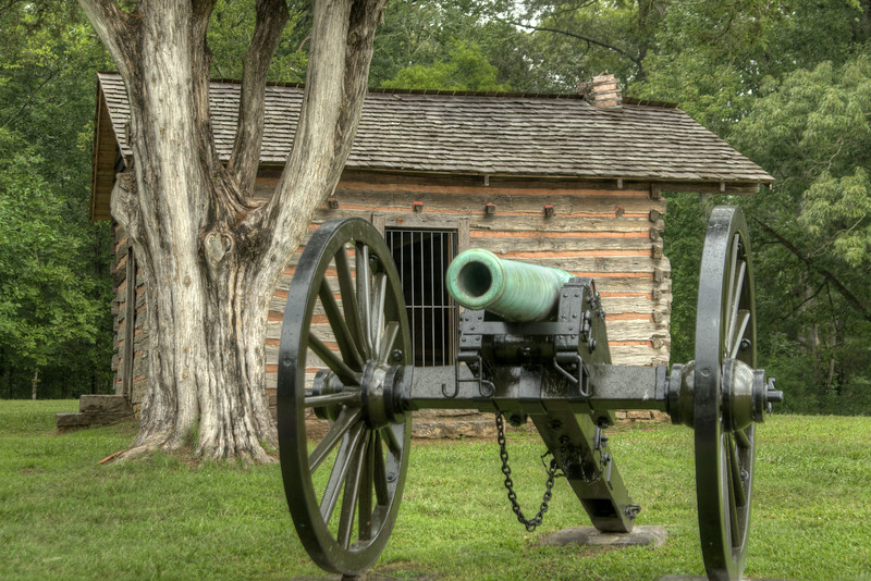 A small log home with a canon in front at Chickamauga & Chattanooga National Military Park in Fort Oglethorpe, GA on Thursday, July 23, 2015. Copyright 2015 Jason Barnette