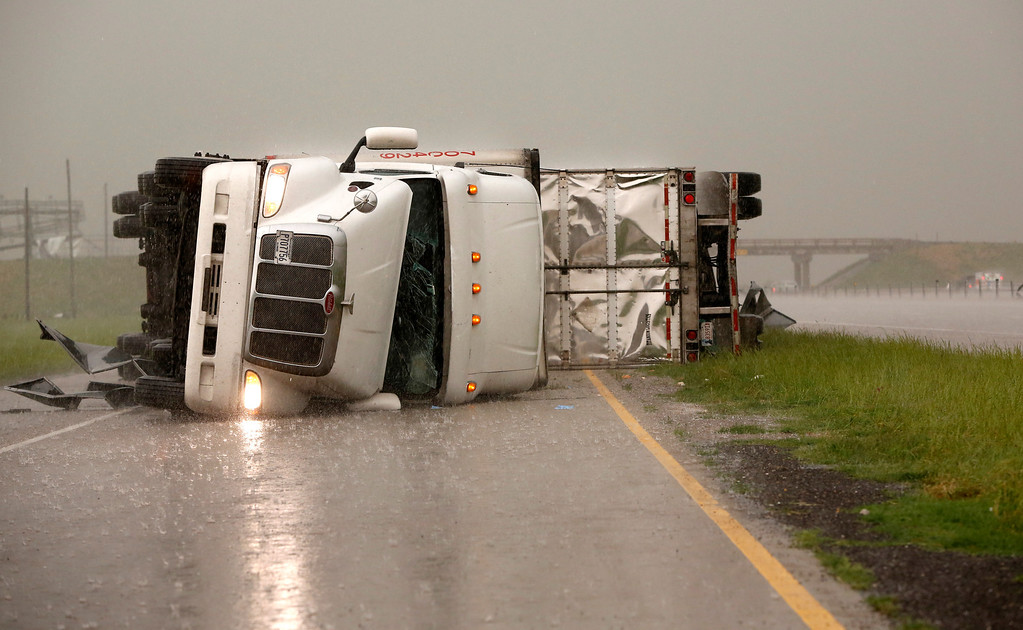 . Overturned trucks block a frontage road off I-40 just east of 81 in El Reno, Okla., after a tornado moved through the area on Friday, May 31, 2013. (AP Photo/The Oklahoman, Jim Beckel)