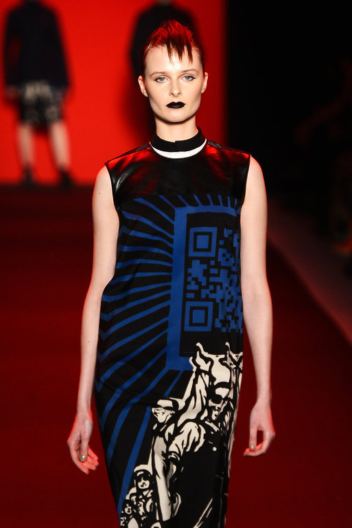 . A model walks the runway at the Vivienne Tam Fall 2013 fashion show with TRESemme during Mercedes-Benz Fashion Week at The Stage at Lincoln Center on February 10, 2013 in New York City.  (Photo by Frazer Harrison/Getty Images for TRESemme)