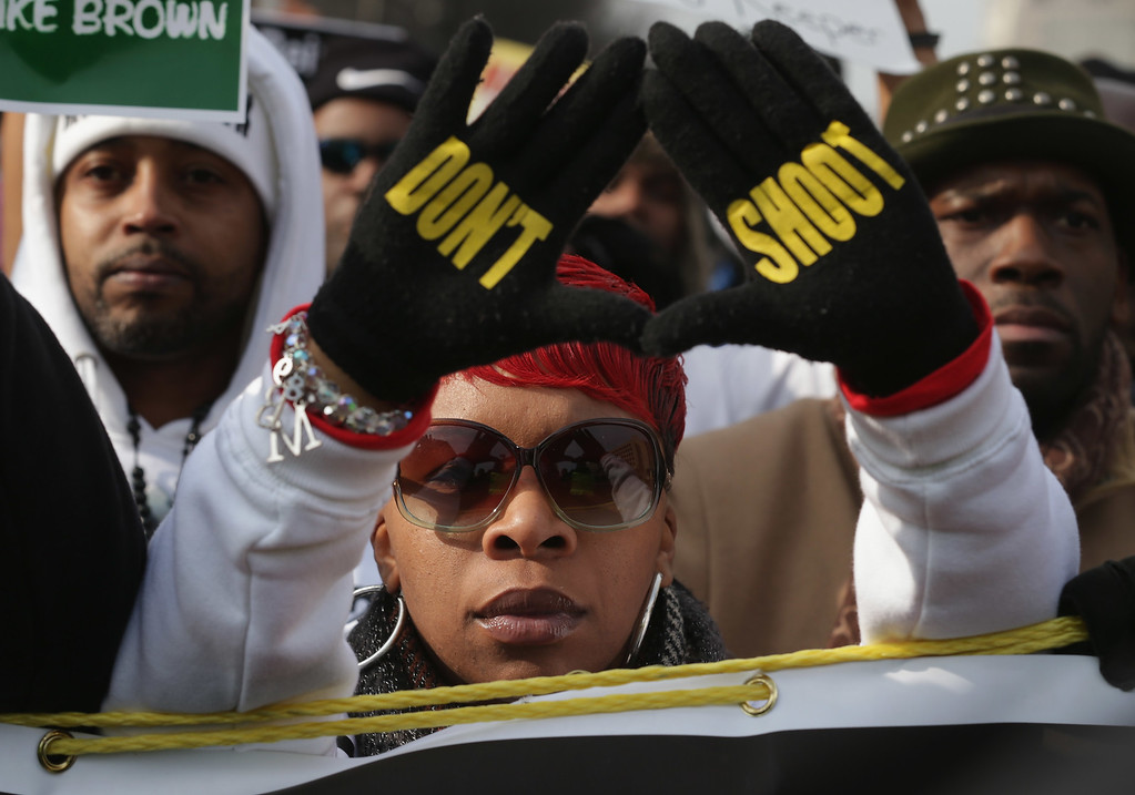 ". Lesley McSpadden, mother of police shooting victim Michael Brown, helps lead the ""Justice For All\"" rally and march against police brutality and the killing of unarmed black men by police in the nation\'s capital, December 13, 2014 in Washington, DC. Organized by Rev. Al Sharpton\'s National Action Network, this march and other like it across the country aim to tell Congress and the country that demonstrators will not stand down until there is systemic change, accountability and justice in cases of police misconduct. Sharpton said the demonstration is happening in Washington \""because all over the country we all need to come together and demand this Congress deal with the issues, that we need laws to protect the citizens in these states from these state grand jurors.\""  (Photo by Chip Somodevilla/Getty Images)"