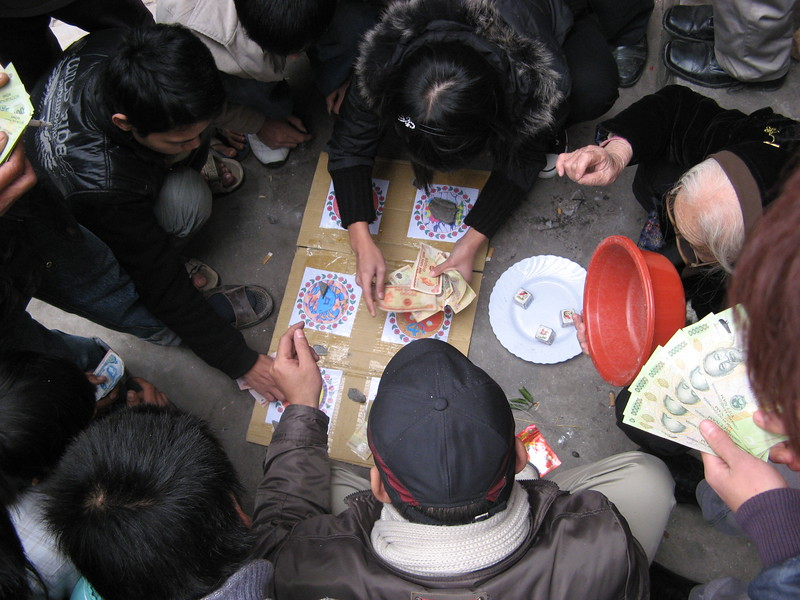Streetside gambling is popular during TET. You put your money on a symbol someone (usually an old lady) rolls the dice and the money is exchanged.